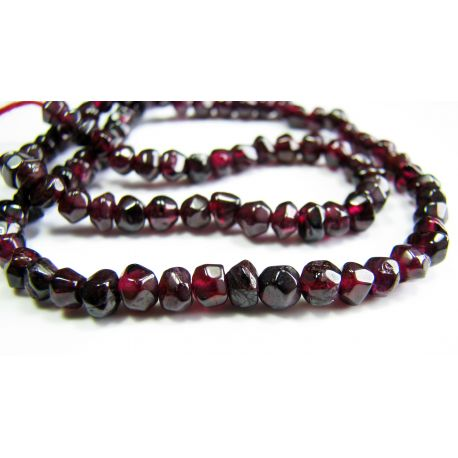 Natural pomegranate stone beads 4-5mm. coarsely ribbed.