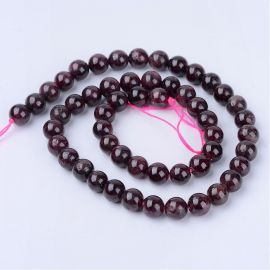 Natural pomegranate beads . Dark cherry color, round shape, price - 5.51 Eur per 1 strand
