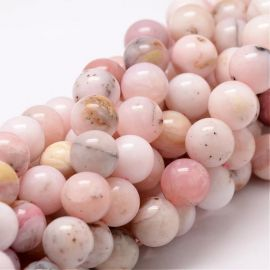 Natural pink opal beads . Pink-yellowish-white with black inserts, round shape, price - 20 Eu