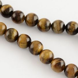 Natural beads of the tiger eye . Brown-yellow, round shape, price - 6.5 Eur per 1guy