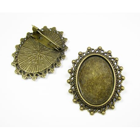 Frame - brooch for cabochon or camouflage, aged bronze swała, 18x25 mm internal dimensions
