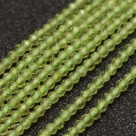 Natūralūs peridoto karoliukai skylės diametras ~0,5 mm.. Šviesiai žalsvos spalvos dydis 2 mm