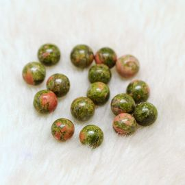 Semi-drilled beads of natural unakit. Green-pink size 8 mm