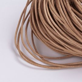 The cord of the natural skin has a specific smell - skin. Light brown, round, price - 0.7 Eur per 1 m.