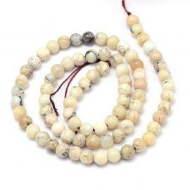 Натуральные бусины African White Opal 6 мм., 1 нитка бело-желтоватые с черными вкраплениями