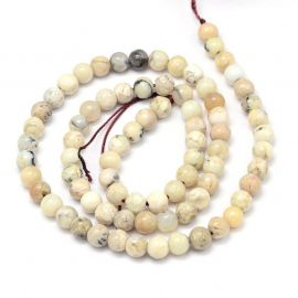 Natural African White Opal beads 6 mm., 1 strand white-yellowish with black inclusions