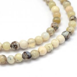 Натуральные бусины African White Opal 4 мм., 1 нитка бело-желтоватые с черными вкраплениями