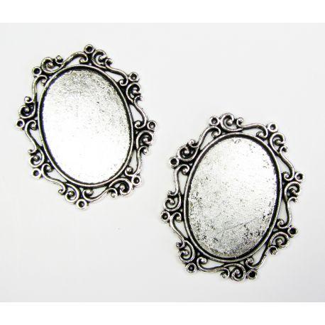 Rėmelis - kabošonui ar kamėjai sendintos sidabro spalvos, ovalo formos 30x22 mm
