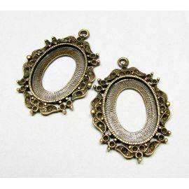 Rėmelis - kabošonui ar kamėjai sendintos bronzinės spalvos, ovalo formos 42x29 mm