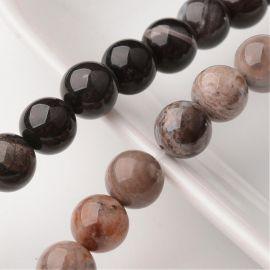 Natūralūs kvarco karoliukai 10,5 mm., 1 gija